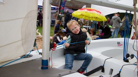 Jack Massey tries his hand on the training boat R.S Vision at the Sidmouth Sea Fest. Ref shs 20 18TI