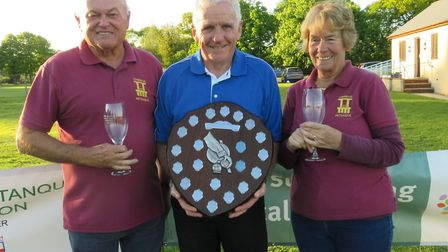 John Thatcher presents the Charity Shield to Torridge petanque players Ged Ann Barton after their wi