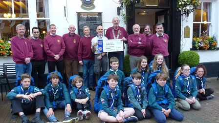 Lion President Mike Sycamore presents cheque to Sidmouth Scout Leader Chris Hodgson with Sidmouth Li