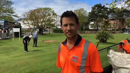 Graham Trude, new gardener, looks after the putting green