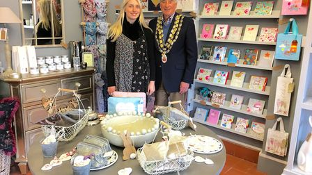 Beth Higgins with former town mayor Alan Dent at the opening of her new Budleigh Salterton shop.