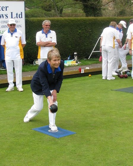 Ottery St Mary bowls club president Maggie Beighton delivers the opening wood of the new outdoor sea