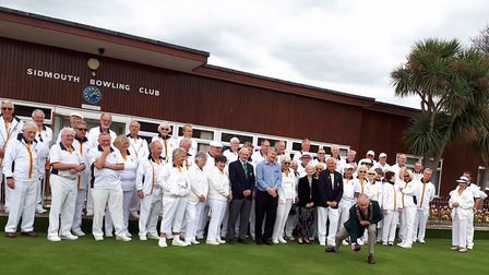 Sidmouth Town council chairman Ian McKenzie-Edwards delivering the first bowl of the 2018 season at
