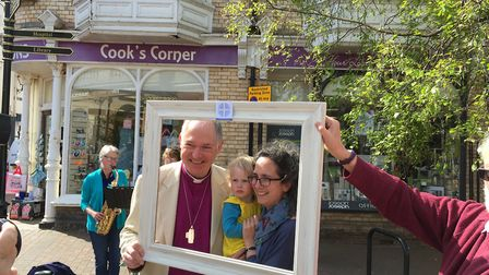 The Bishop of Exeter poses for photographs in Market Square as part of a 'Meet the Bishop' day.