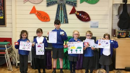 Sidbury WI presented vouchers to winners of its speed poster competition. From left to right, Isabel