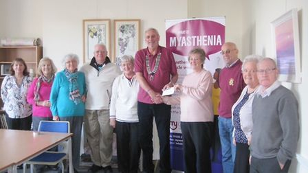 Members of Myaware's Devon group accept a cheque for £300 from the Lions Club of Sidmouth.