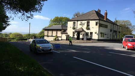 Diversions in place as road closed at The Halfway Inn on the A3052 because of accident.