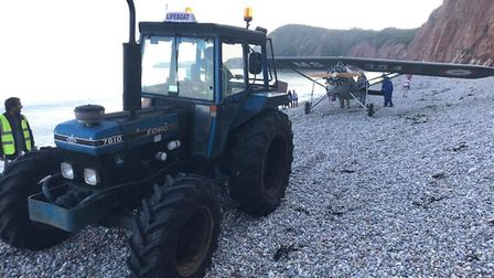 Sidmouth Lifeboat and the coastguard help to recover a plane at Jacob's Ladder beach. Picture: Senio