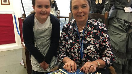 Lacemaking exhibit at Sidmouth Museum - Amy Russell learns from Volunteer Bee Barford