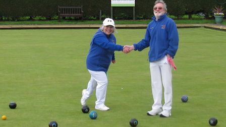A sporting handshake between Gail Hawke and Steve Hall at the conclusion of the Ottery St Mary Bowls