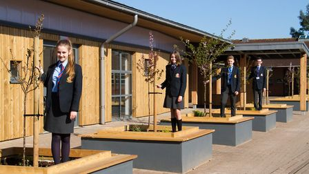 Kings School's students with the trees donated by Otter Nurseries outside the new canteen. Ref sho 1