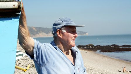 Fisherman Peter Bartlett on the beach at Beer