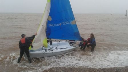 A dinghy crew getting ready for action off Sidmouth.