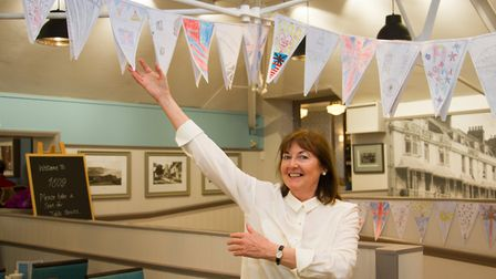 Fields sales asitant Pauline Heywood with some of the bunting from Sidbury Primary School. Ref shs