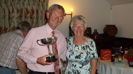 The Sidmouth 2018 indoor men's champion Ken Wheeler being presented with his trophy by ladies captai