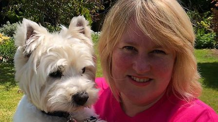 Angela Reid with her pet Alfie is going to walk three miles a day, or 190 miles across two months to