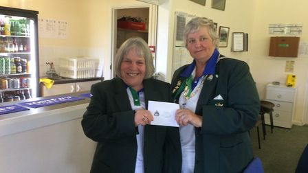 Devon Bowls lady president Vicky Kingston presents Ottery St Mary bowler Gail Hawke with her county