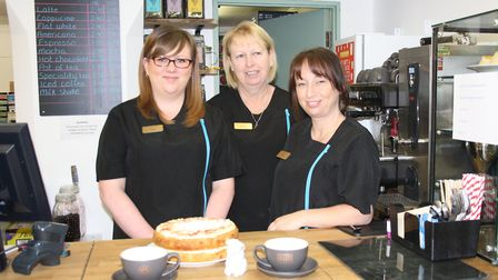 Owner Teresa Loynd (centre) with members of her team behind the counter of the new tearoom which she