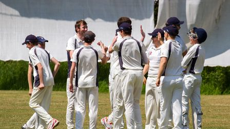 Ottery 2nds celebrate an early wicket at home to Axminster 1st team. Ref shsp 21 18TI 3752. Picture: