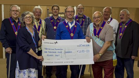 Beer Buffs present their cheque to the British Lung Foundation. Picture: SUBMITTED