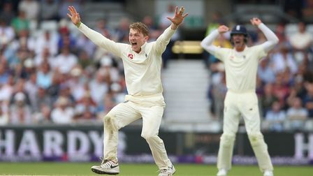 England's Dom Bess celebrates after taking the wicket of Pakistan's Imam ul-Haq during day three of