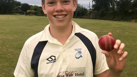 Ottery St mary U14 bowler Max Mayor with the match ball after his six wicket for no runs return in t