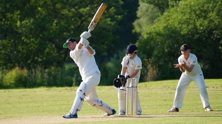 Dave Alford hits out for Tipton St John in the game against East Devon Under-13s. Matt Jeacock is be