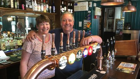 Julia and Adrian Ricketts behind the new taps at The Swan Inn