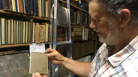 David Strange of the Norman Lockyer Observatory examines glass plate from 1933