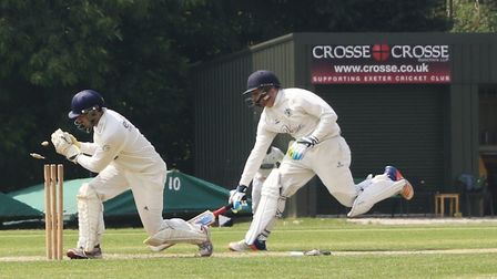 James Bovey is short of his ground as a throw comes in to Sidmouth wicket keeper cameron Evans-Grain