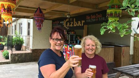 Landlady Karen Griggs and Barmaid Chrissie Worthington toast the new outdoor bar at The Balfour Arms