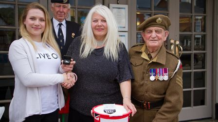 Amanda Marks of Sidmouth cinema has been given a commemorative coin for her fundraising for the popp