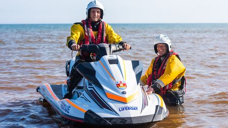 Members of Sidmouth Lifeboat crew show how the new rescue ski will be used in callouts. CREDIT: Kyle
