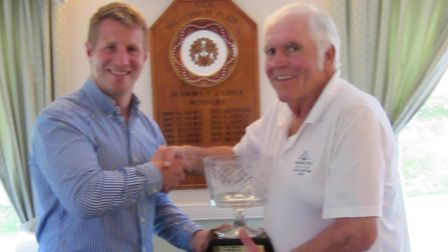 Royal Marines golf team captain Stu Morgan (left) presents the 'Towards the Sea' trophy to Sidmouth