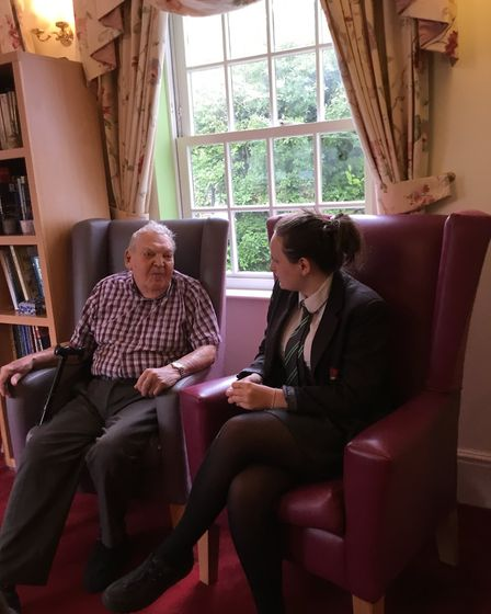 One of the students with one of Malden House's residents.