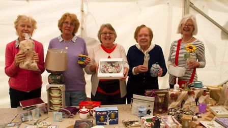 Volunteers with some of their things for sale at Sidbury Fete. Ref shs 25 18TI 5747. Picture: Terry
