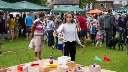 Trying her luck on the hoopla stall at Sidbury Fete. Ref shs 25 18TI 5736. Picture: Terry Ife