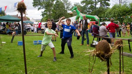 Taking aim on the coconut shy stall at Sidbury Fete. Ref shs 25 18TI 5732. Picture: Terry Ife