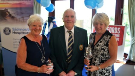 Sidmouth captain Coilin Macklin with Marie Timms and Sheila Faulkner, winners of the ladies prizes a