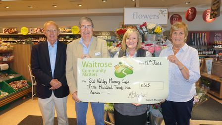 Members of the memory cafe receive a cheque. From l-r: Adrian Ford, Duncan Watt, Julie Marish (Waitr