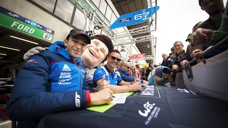Harry Tincknell signing autographs after the 2018 Le Mans 24 Hour race.