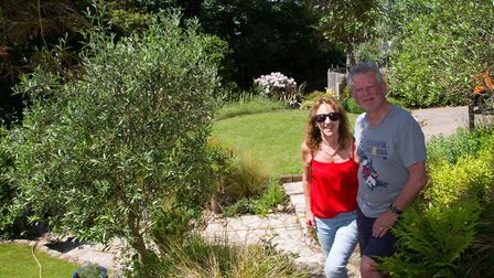 Carolyn and Colin Trussell in their garden for Sidmouth in Bloom open gardens. Ref shs 24 18TI 5083.