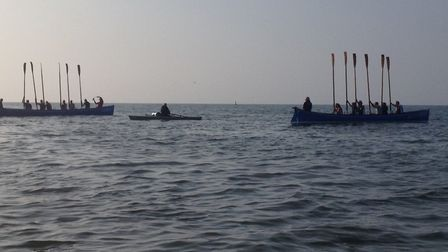 The Sidmouth Gig Club crews raise their oars in honour of the end of the terrific charity row comple