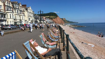 Soaking up the sun on the esplanade in Sidmouth