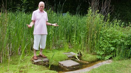 Simon Papworth at the pond in The Knapp. Ref shs 25 18TI 6057. Picture: Terry Ife