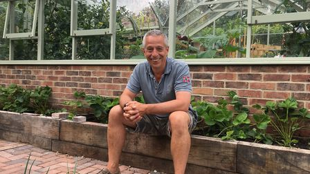 Ian Barlow outside his greenhouse is looking to either buy back his old buisness or build a new one