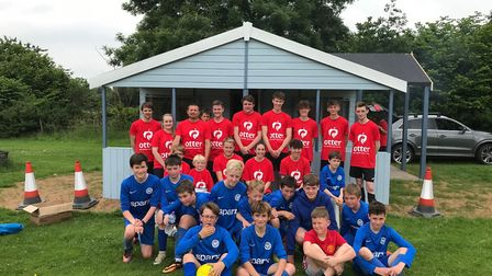 Members of the Ottery Youth Football Club are photoed outside the new summerhouse that has been dona