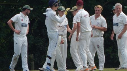 Sidmouth III celebrate taking a Bradninch 2nds wicket