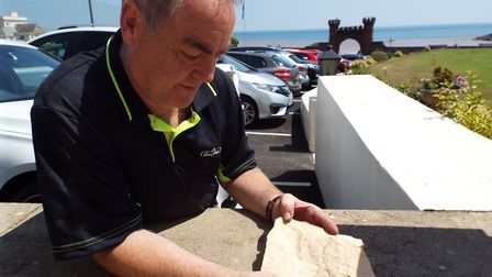 Marc Coulson showing the note found in the tin.