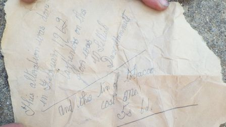 The note found inside the tabocco tin.